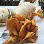 """The pastrami wrap, with a side of """"sidewinder"""" fries."""