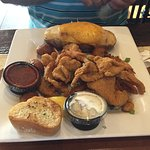 Delicious food, fast friendly service! The grilled redfish is excellent, and the fried shrimp ar