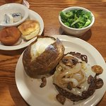 Great evening dinner mushrooms swiss cheese onions ground patty and baked potato and broccoli