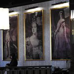 Q Bar decor - paintings / murals of Queen Victoria on wall.