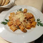 Pasta with tomato sauce and mini croquettes