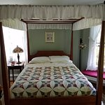 View of queen bed