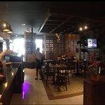 Foto do ambiente de atendimento no Fogão a Lenha Cafe
