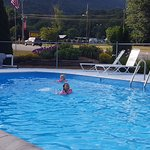 Nice and clean outdoor pool with a scenic view of the high mountain side.