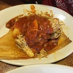 Tamal with shredded chicken on top