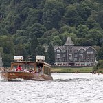 The hotel in the background is served by regular steamer visits