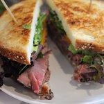 Roast Beef Sandwich: red union, lettuce, tomato, provolone, horseradish, mayonnaise.