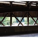 Looking out from inside the covered bridge down the street