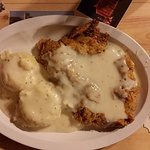 Large chicken fried steak with 2 sides of mashed potatoes.