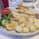 Main course of sea bass, salad and new potatoes
