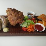 "Our famous crispy pork knuckle ""Haxe""."