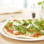PIZZA BRUSCHETTA Tomatoes marinated in garlic, basil and extra virgin olive oil with rocket and