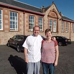 Your hosts, Willie and Kirsteen, in front of the Lodge
