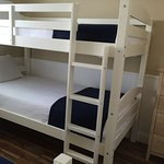Kids bunkroom with twin and twin over twin bunks.