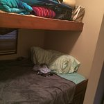 The second bedroom with a double bunk on bottom and single on top