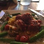 Chicken meatballs with tomato sauce over spaghetti squash and asparagus