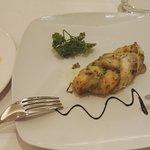 Pesce gratinato con insalata
