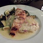 Grilled salmon in beurre blanc with grilled vegetables