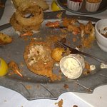 Fried seafood platter (after) I swear I don't usually eat like a Tazmanian Devil, just looks lik