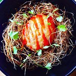 Crispy Free Range Egg in nest with Sriracha from bar snacks menu