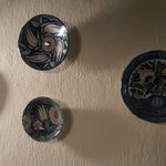 Beautiful ceramic plates decorate the walls