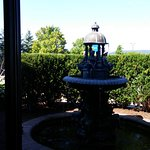 Fountain in garden outside lounge window.