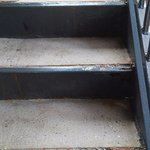 Crumbling stairs show the age of this older roadside motel