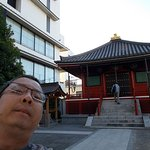 Me on Edo Dori, just behind the shrine is the lane where the Guesthouse is on