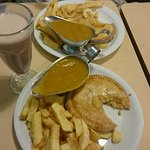 cheese and onion pie, chips and curry sauce with a milkshake