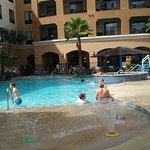 Kids splash area, hot tub, swim up bar and then pool goes indoors to the left.