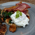 Poached egg with bacon, spinach and wild mushrooms on toast