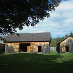 The three reconstructed barns - Horse Barn (left), Big Barn (middle), and the South Barn (right)