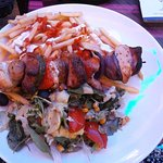 Chicken Skewer served with chips and salad