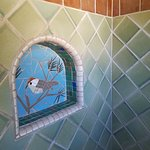 Shower shelf with sparrow mosaic