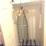 Closet with ironing board and iron