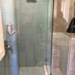 Loved this green glass-tile walk in shower.