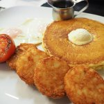 'Tookie' breakfast: two pancakes served with whipped butter, hash browns, eggs and grilled tomat