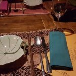Table setting with our menu for the evening
