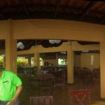 Panorama view of the open area dining right beside the beach.