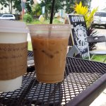 Barista hand writes motivational quotes on the coffee sleeves.