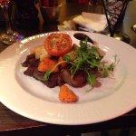 ribeye steak with black pepper sauce aside.