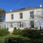 of house with conservatory where food is served and cream teas.