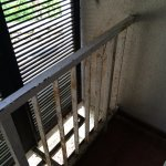 Rusty fence in the room. Not suitable to hang the towels.