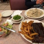 Spare ribs came with fresh salad and your choice of vegetables, in the back, beef Stroganoff /w