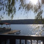 View from the deck of the willows and Jim's boat and the crystal clear lake!