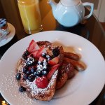 Challal French toast with fresh fruit for breakfast, served in the guests' rooms.