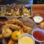 Double Stacked Nachos with Steak and Chicken Strips, Fried Prawns and Fire Fries.