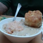 Shrimp and grits with sausage gravy on top and great tasting biscuit