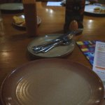 The plates and cutlery, with the peri-peri sauces