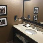 Bathroom vanity; local 'Falls photos' on the wall